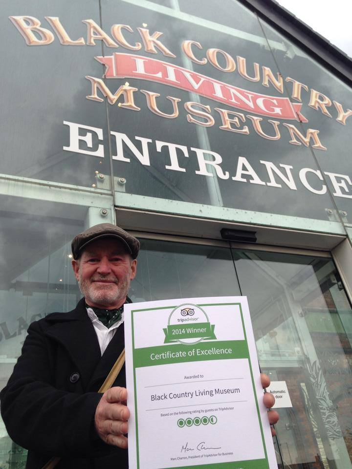 Costumed Demonstrator, Colin shows off BCLM's TripAdvisor Certificate of Excellence